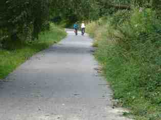 Cyclists on the Fallowfield Loop after clearance of fallen trees